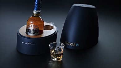 Chivas 18 by Pininfarina has a rich metallic exterior with a warm wooden interior.