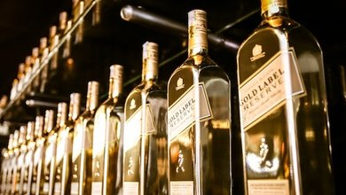The Johnnie Walker Gold Label Limited Edition bottle's metalized gold finish perfectly captures the festive spirit of the celebration blend.
