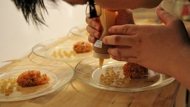 Nicklaus Au deftly preparing a dish at one of KL's newest and most innovative supper clubs.