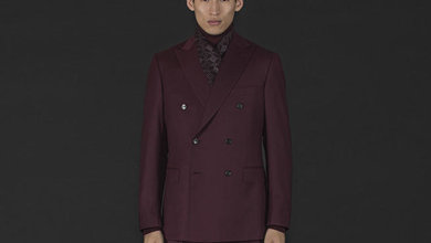 "Double-breasted jackets feature prominently in Brioni's offerings for A/W 2013. Here, a fine wool suit is drenched in rich Bordeaux, an on-trend monochromatic look that's referred to in fashion-speak as ""through colour""."